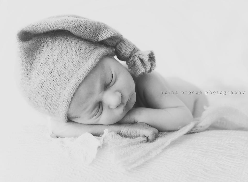 newborn baby boy sleeping with hat