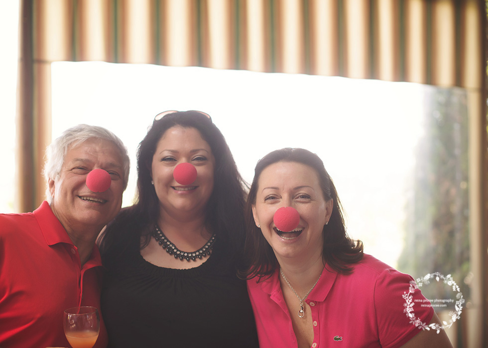 two women and man with clown noses