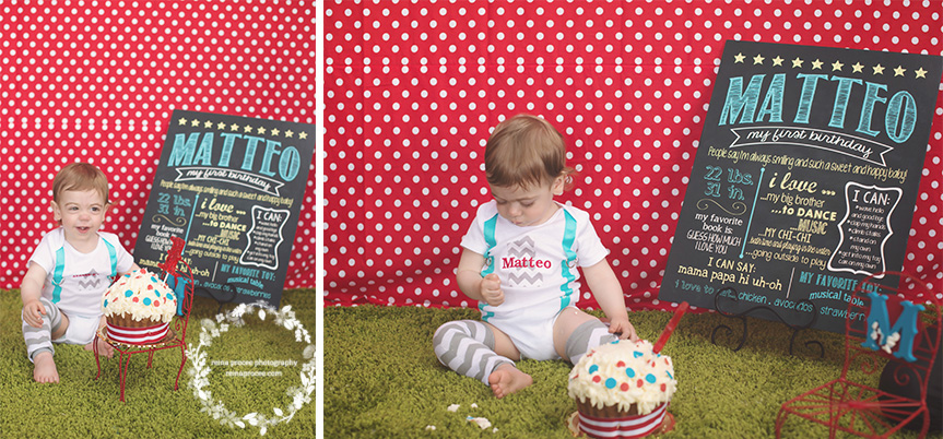 little boy smashing a cake red and white polka dot backdrop