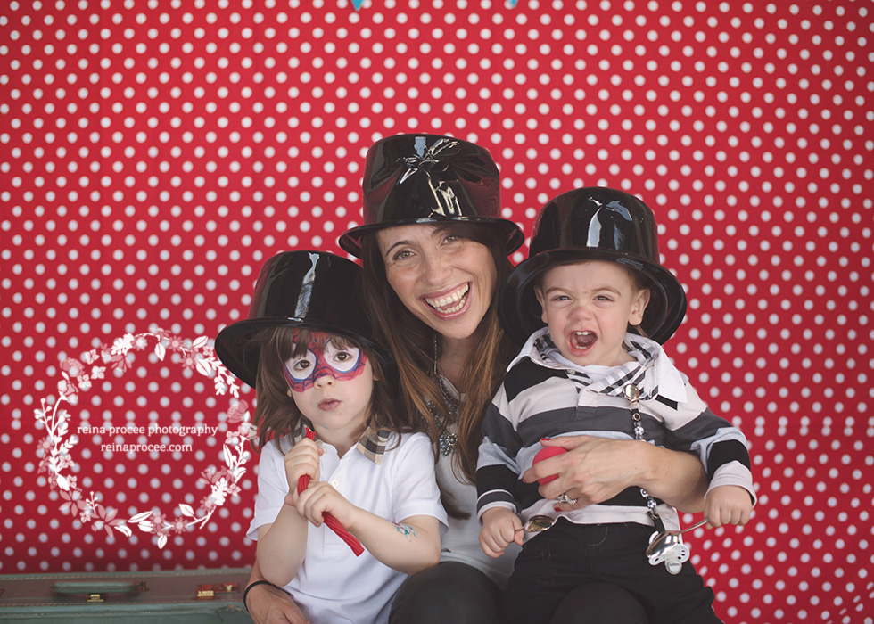 mom with little boys red and white polka dot backdrop