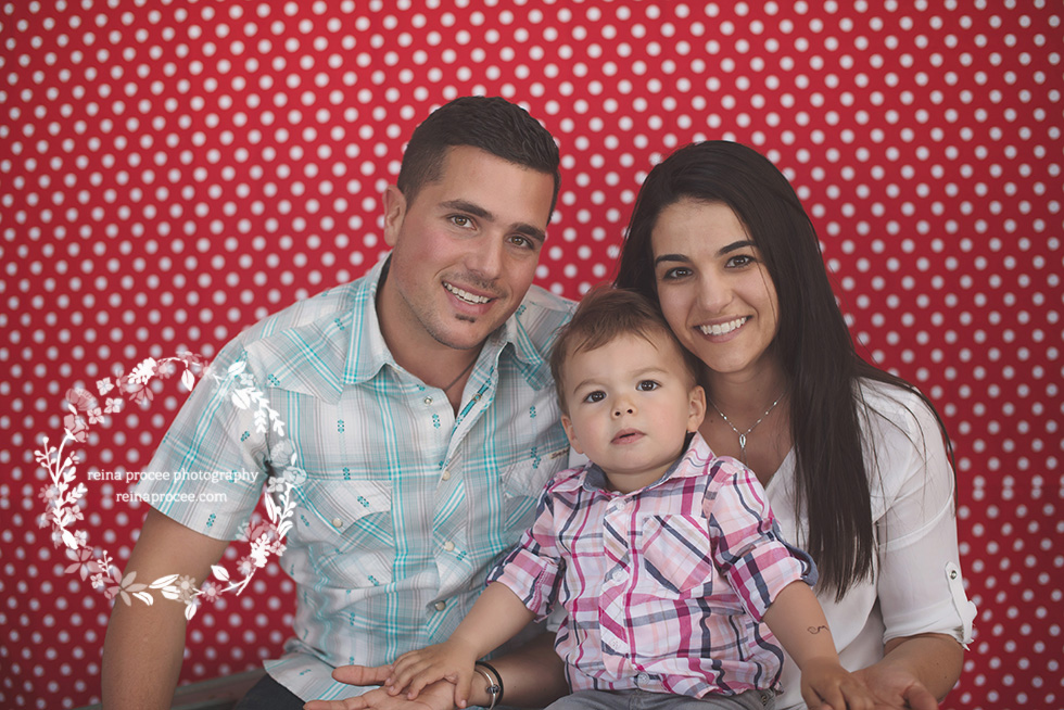 family with little boy red and white polka dot backdrop