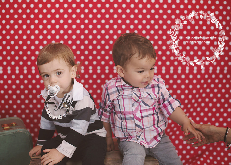two little boys red and white polka dot backdrop