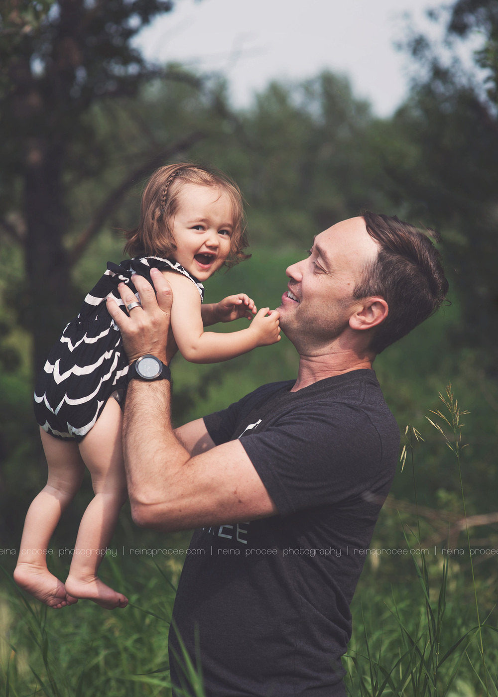 dad holding daughter up