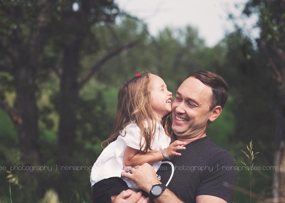 dad tickling daughter