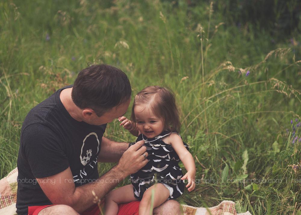 dad is tickling daughter