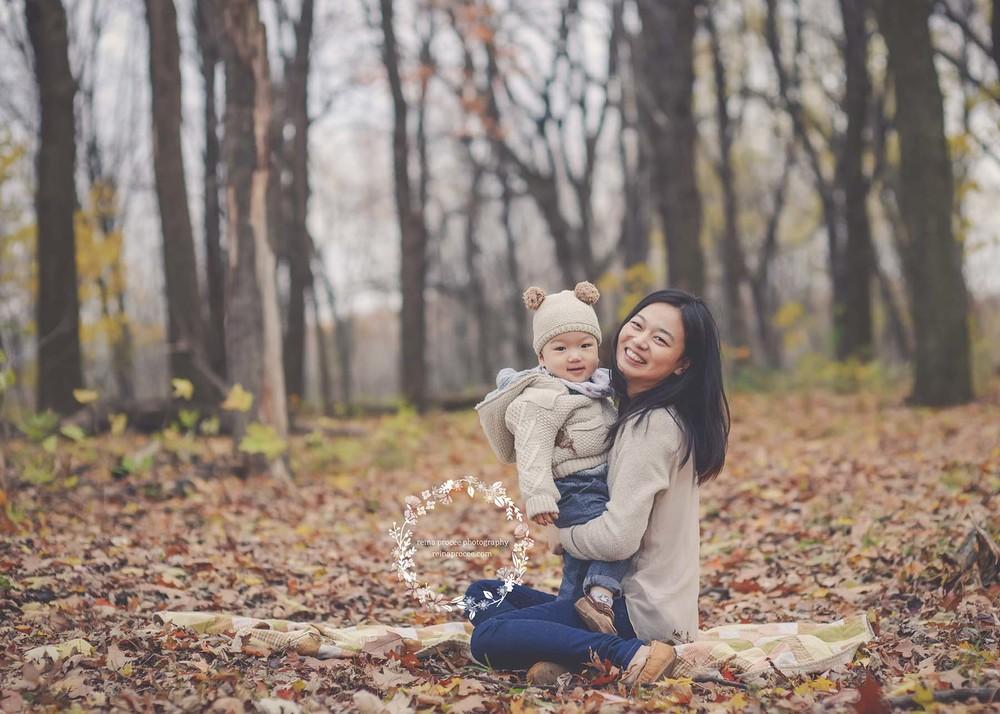 little boy sitting with mom