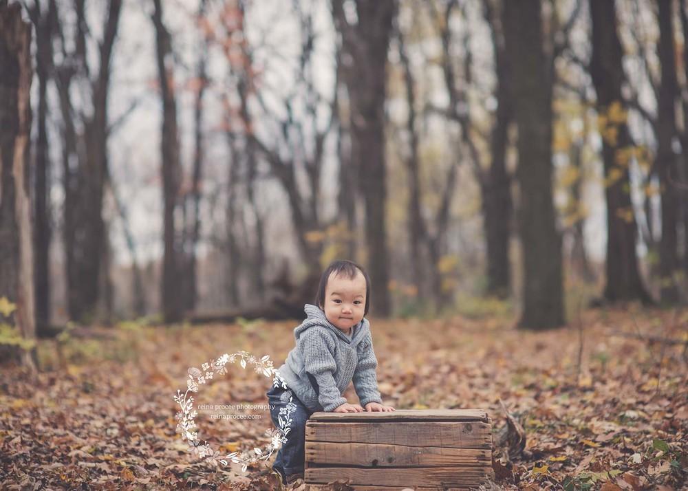 little boy walking around a crate