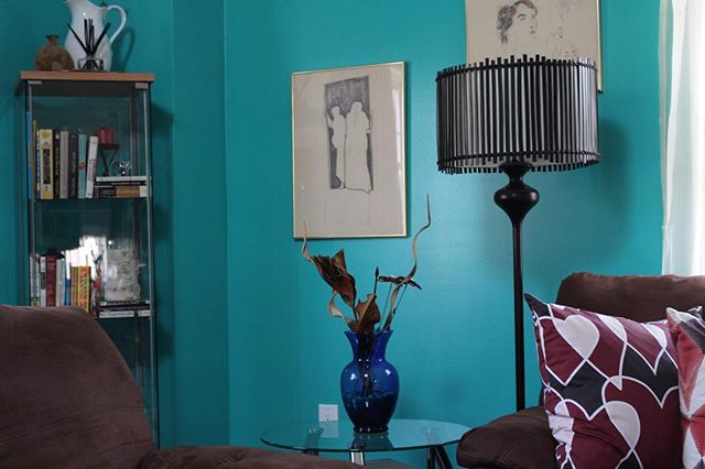 With a high ceiling, I painted my LR this beautiful turquoise green knowing that it with would bring warmth into my space all season long and bring the eyes closer to the surface to take in all the beautiful furnishings, without creating clutter, our sweetheart pillow adds even more beauty to the space  #interiors #decorate #furnishings #textiles #design #residential #interiordecorate #pillowdesign original Artwork done by @chzld_chris