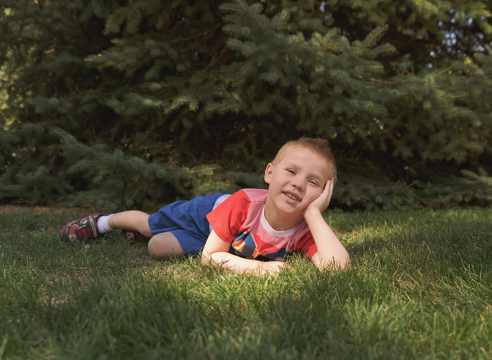 Dear Me Photography Child laying on the ground posing