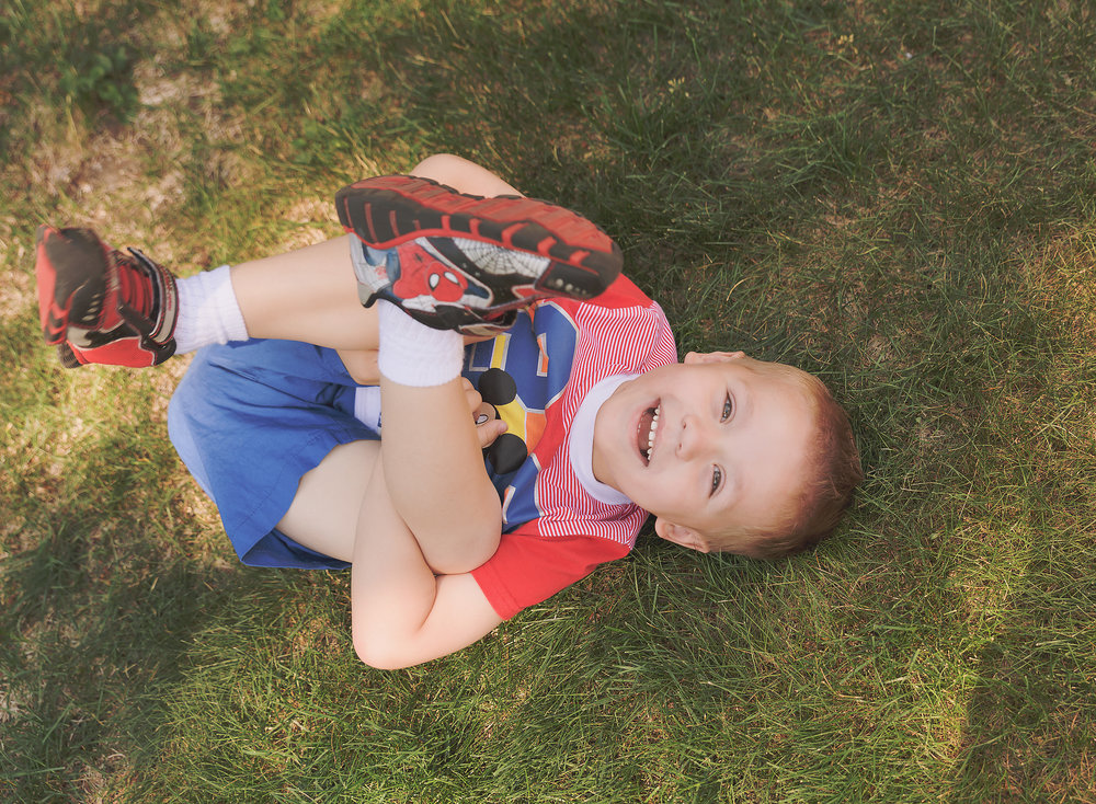 Dear Me Photography 4 year old boy being silly in the grass