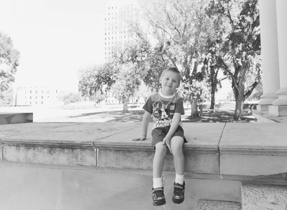 Dear Me Photography boy sitting on ledge in black and white