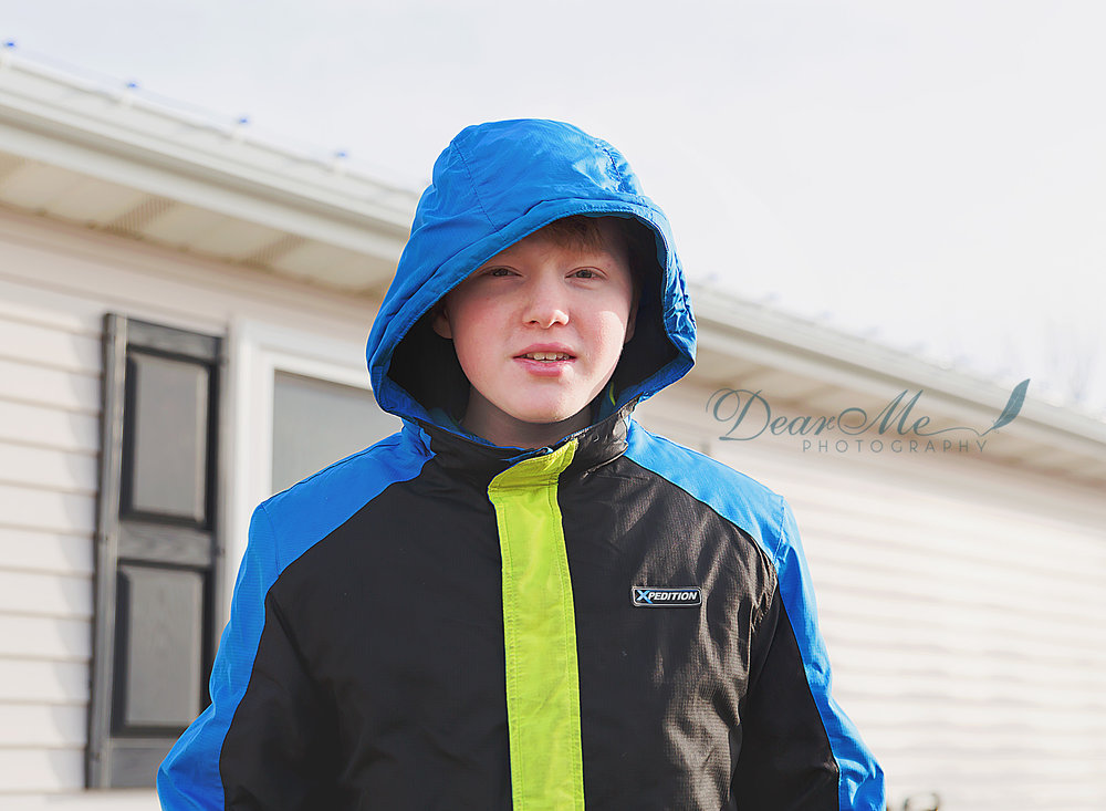 dear me photography bismarck teen boy with hood on outside a building