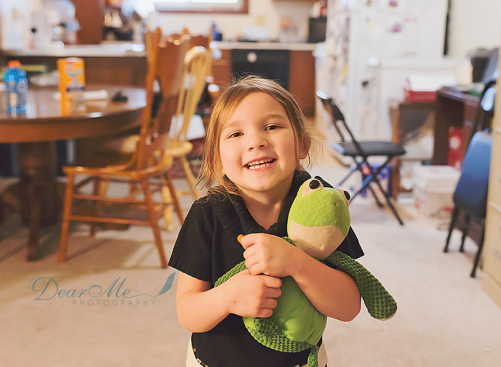 dear me photography bismarck nd child photographer girl smiling with kitchen in the background