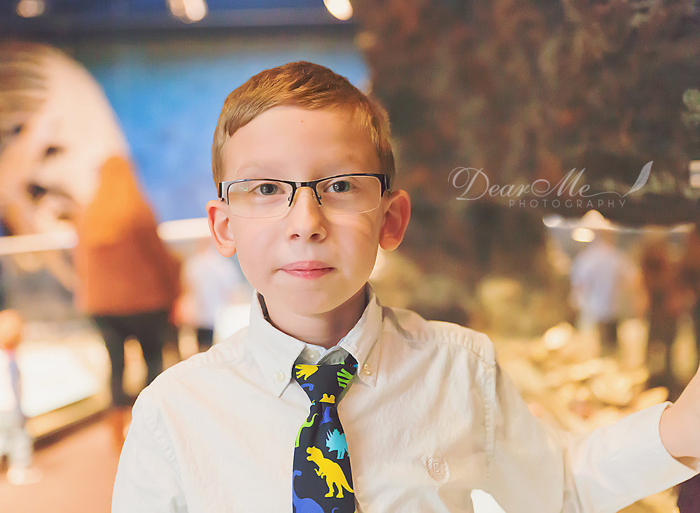 dear me photography bismarck photographer boy in dinosaur tie