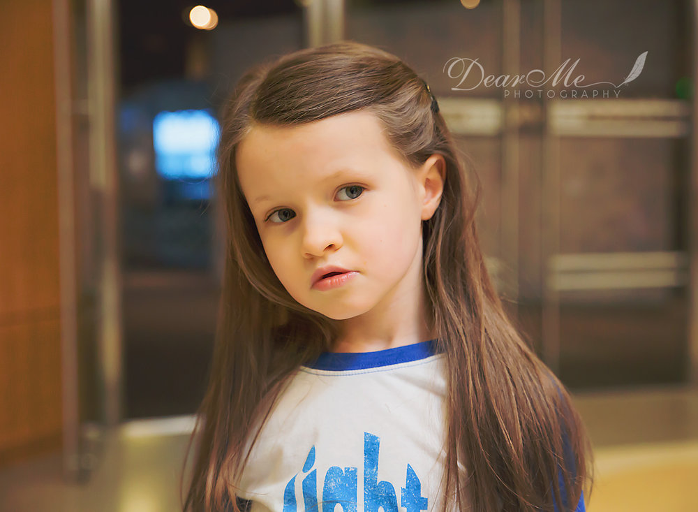 dear me photography bismarck child photographer girl with hair tucked behind her ear