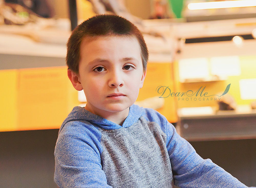 dear me photography bismarck photographer boy with serious face looking at the camera