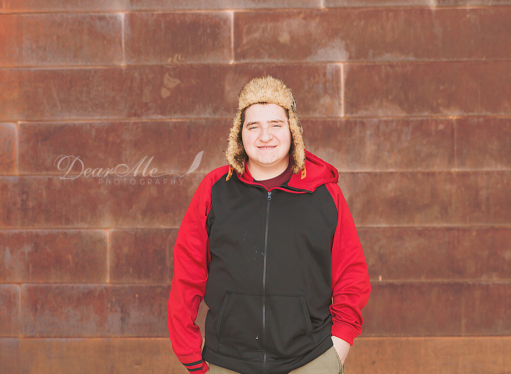 dear me photography bismarck teen photographer teenage boy in hat and hands in pockets