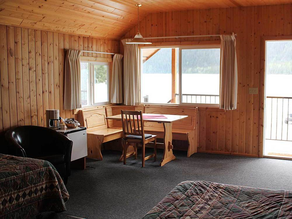 Log cabin inspired interior of the lakeshore chalet, a perfect place to relax and unwind after a day of adventures in the Muskwa Kechika.