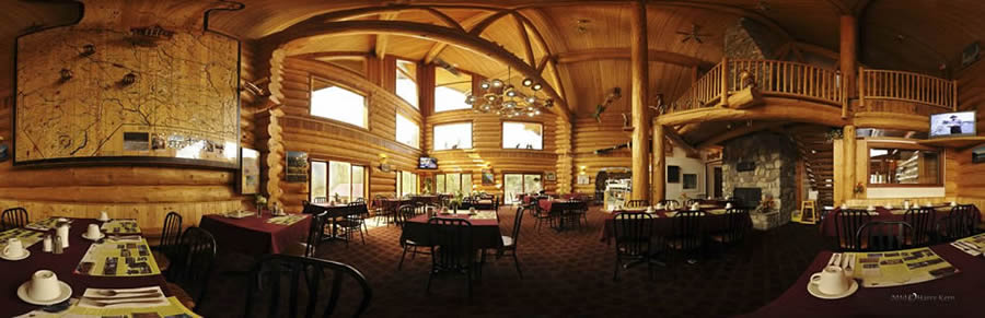 Our log cabin inspired dining room with wide windows overlooking the rest of the property and the lake. As a nature tour package guest, you will get access to the exclusive lounge.