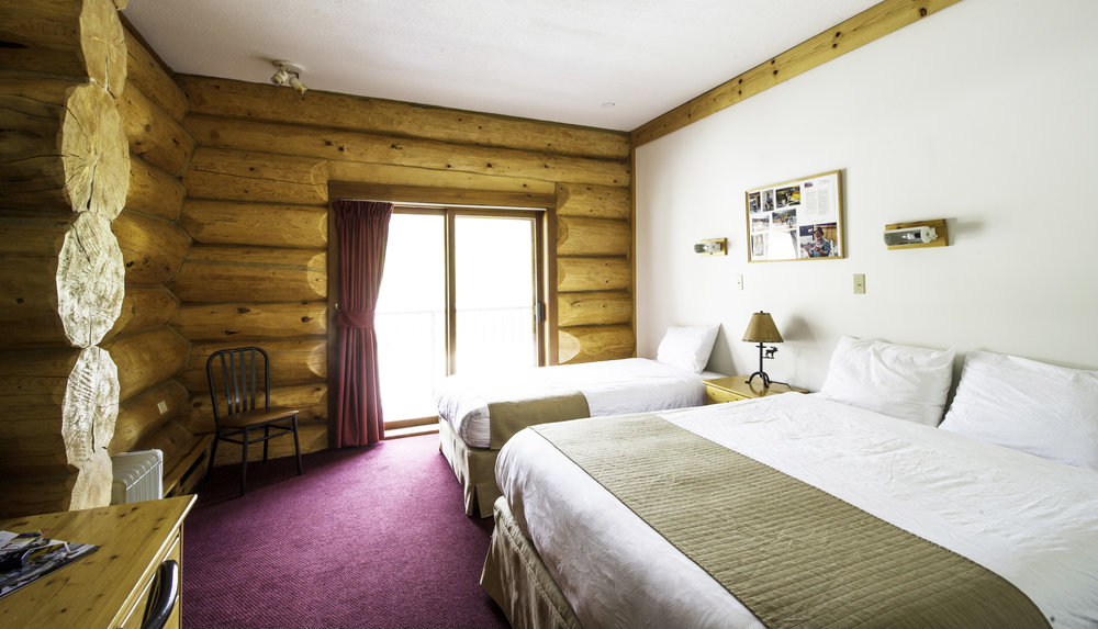 "Hotel Rooms (Open year round)   Our lodge rooms are designed in the log-cabin style. All rooms feature a 32"" LCD TV with satellite, WIFI internet, modern full en-suite washroom with a bathtub & shower, and a hairdryer."