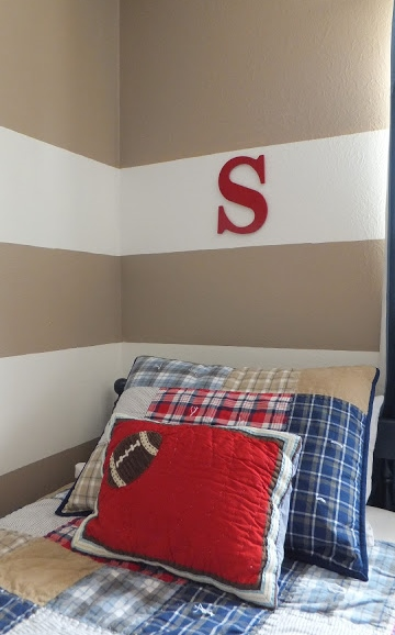 Initials over the bed