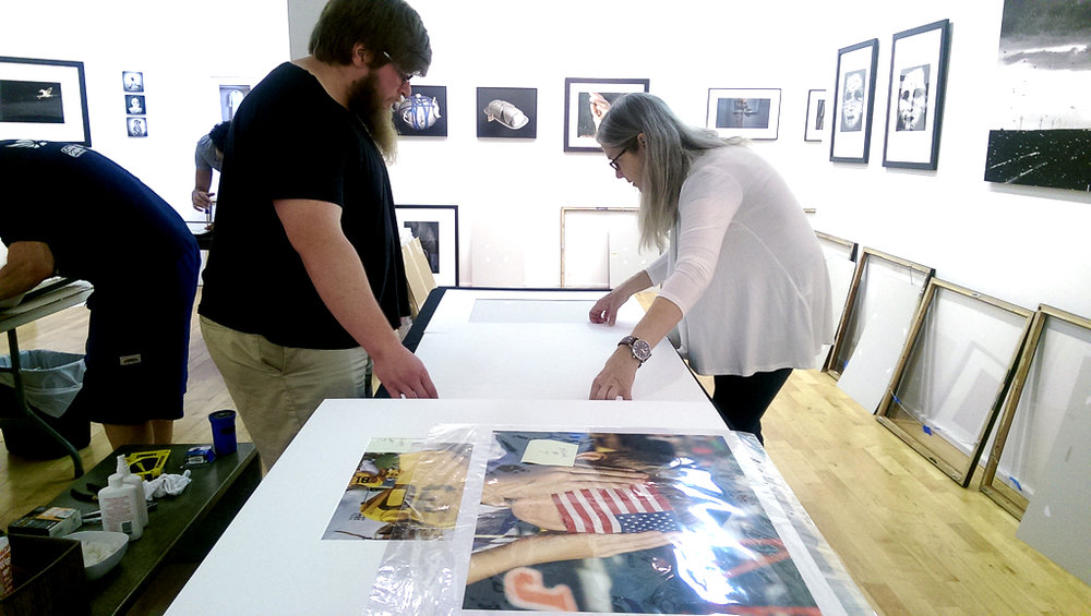 Volunteer Nick Ashton helps executive director Beth Lilly frame work for the annual Airport Show.