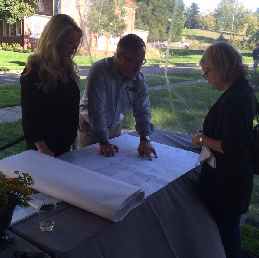 PICTURED ABOVE: Candace Taylor and Dean Jones of Realogics Sotheby's International Realty review a set of blueprints with a prospective homebuyer that is considering a large home at Officer's Row to be released in early 2016.