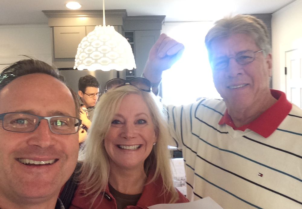 Dean Jones, President & CEO of Realogics Sotheby's International Realty (left) takes a selfie with Candy and Jeff Bannister of Mercer Island, who are exploring The Homes at Fort Lawton as new empty-nesters after dropping their last child off at university.