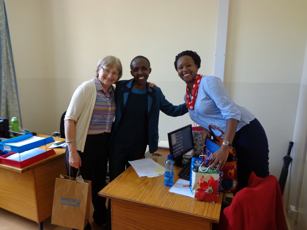 Mary with Jennifer Kinoti, and Barbara Ntoipo in the Student Finance Office on a trip to Daystar University in December 2015.