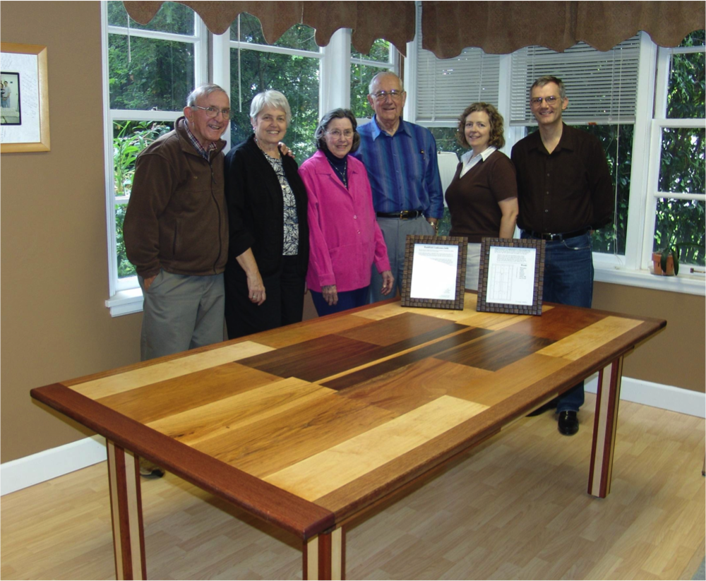 From Left to Right: Table maker E. R. Krueger, his wife, Mrs. & Dr. Smith, and staff at WorldView