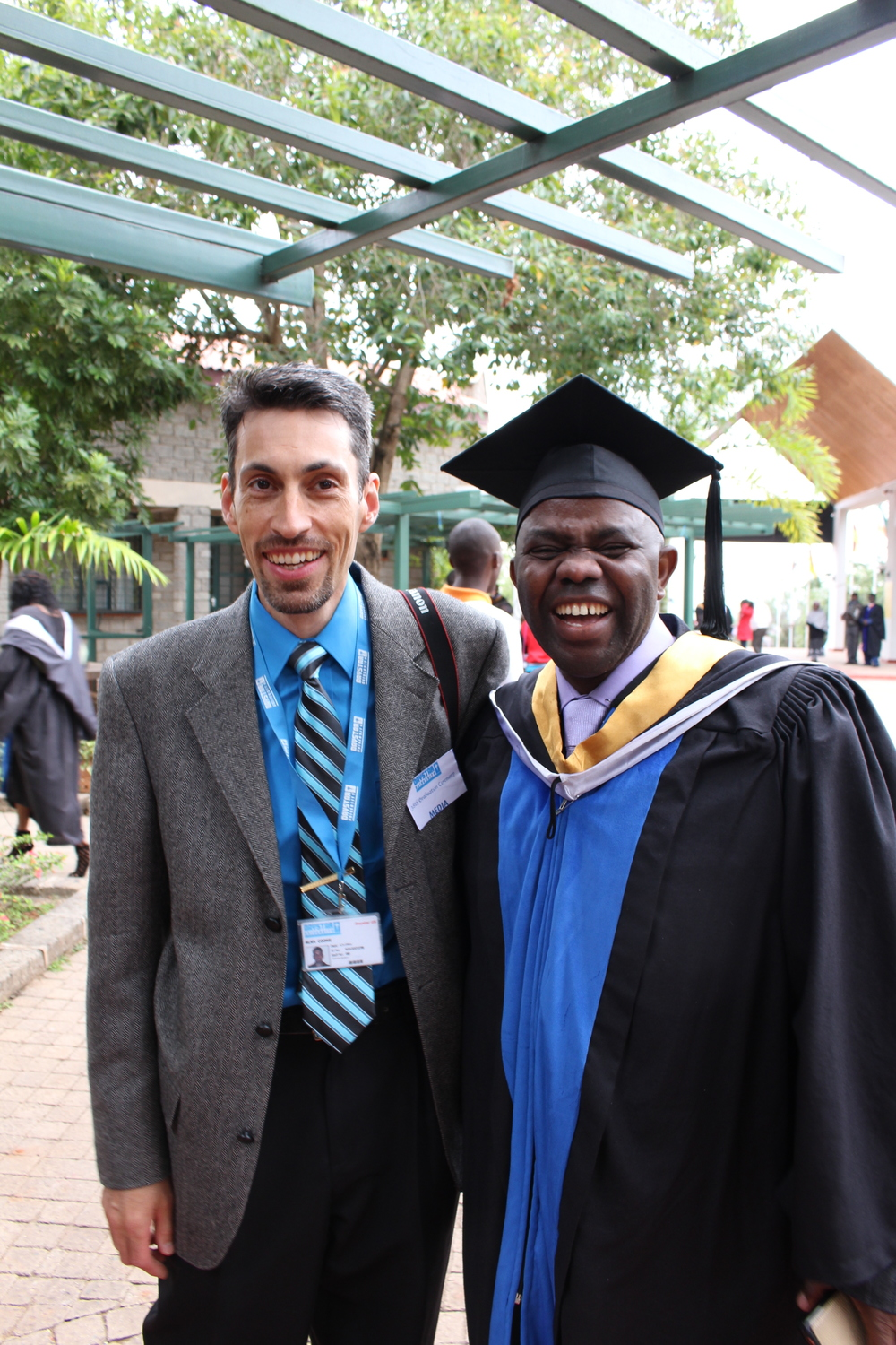 Alan Cooke, our Assistant Director, with his good friend Evariste at graduation.