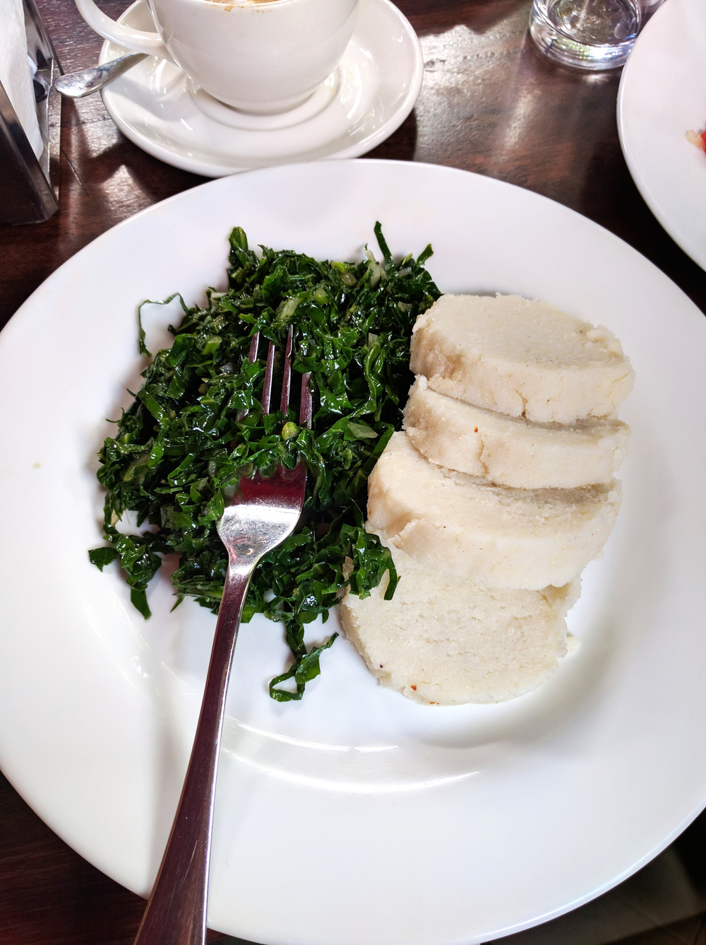 We tried some traditional Kenyan food: ugali, a dish made of cornmeal cooked in boiling liquid to a dough-like consistency, and sukuma wiki, a kale-like green.