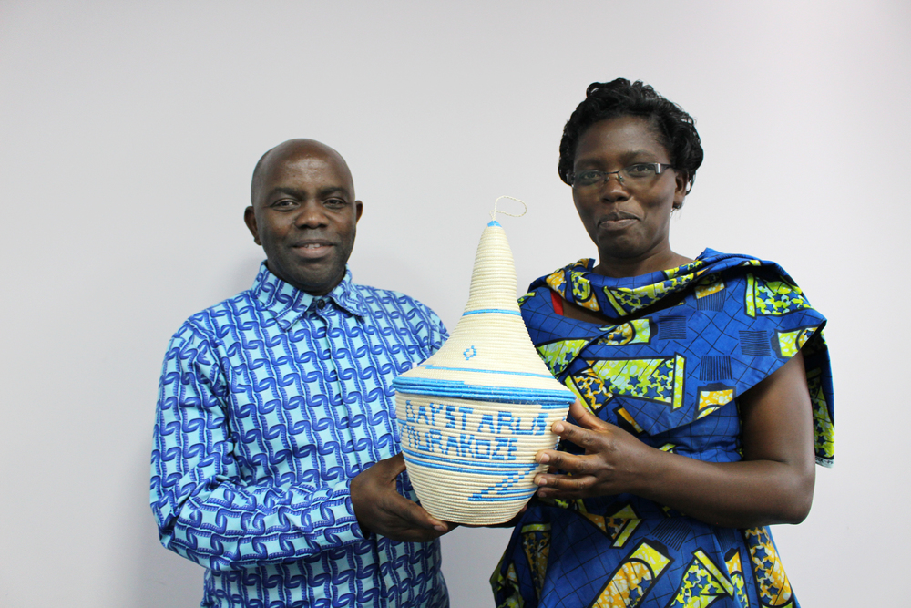 """Evariste and his wife Gertrude are both Daystar alumni. The Daystar U.S. office supported both of their educations with scholarships. To show their gratitude they presented us with this homemade basket that reads, """"Daystar US murakoze"""". Murakoze means thank you in Burundi."""