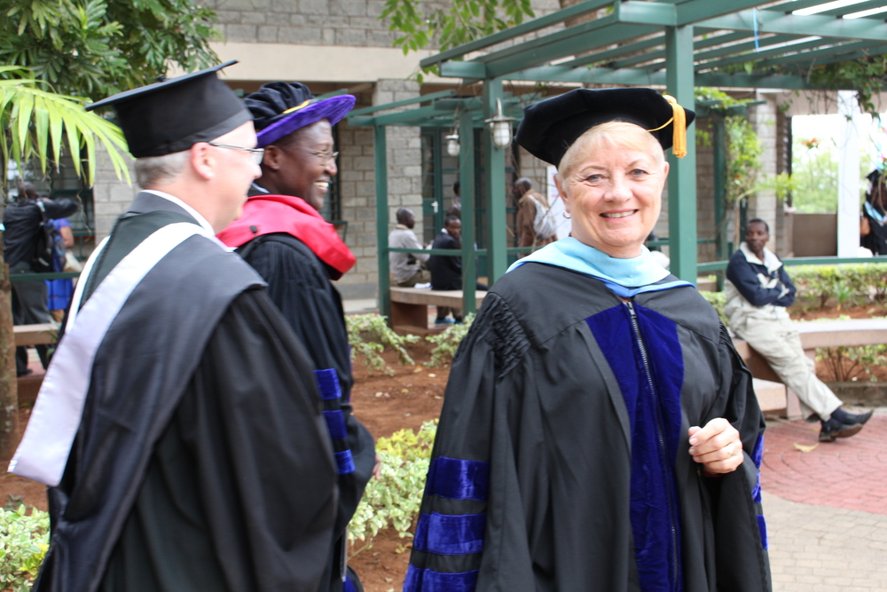 Kathy walking in the faculty and academic procession at Daystar's graduation ceremony in June 2016.