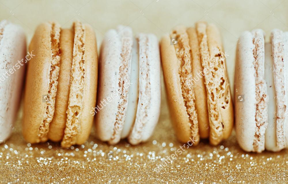 stock-photo-luxury-vanilla-and-caramel-macaroons-on-gold-background-181704647.jpg