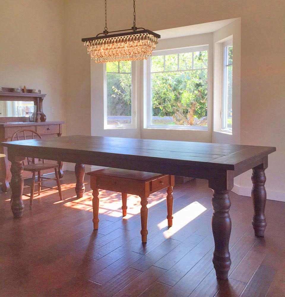 8 foot, farmhouse table with handturned legs. This table was beautifully finished by the client themselves!