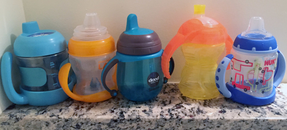A few of the Sippy Cups we tried - from left to right - Oxo Tot, Munchkin Latch, Joovy Dood, Munchkin Click Lock, & NUK