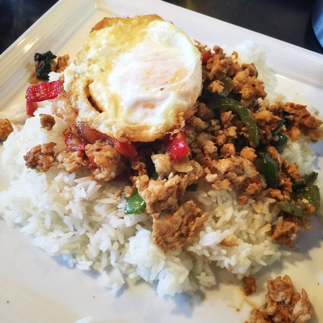 Kow Lhad Nha Gapow. Your choice of chicken, pork or beef, chopped and stir-fried with sweet Thai basil and bell peppers, served over steamed rice and topped with a fried egg. #thai #Thaifood #waiwai #waiwaitp #overlandpark #kansas #kc #kansas #foodkc #foodporn #instafood #instakc #easter #thaiforeaster #delicious #egg #rice #saturday
