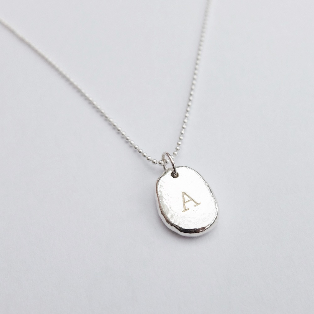 personalised letter stamped engraved pebble A on ball chain pendant necklace contemporary sterling silver jewellery handmade in Exeter Devon UK jasmine bowden.jpg