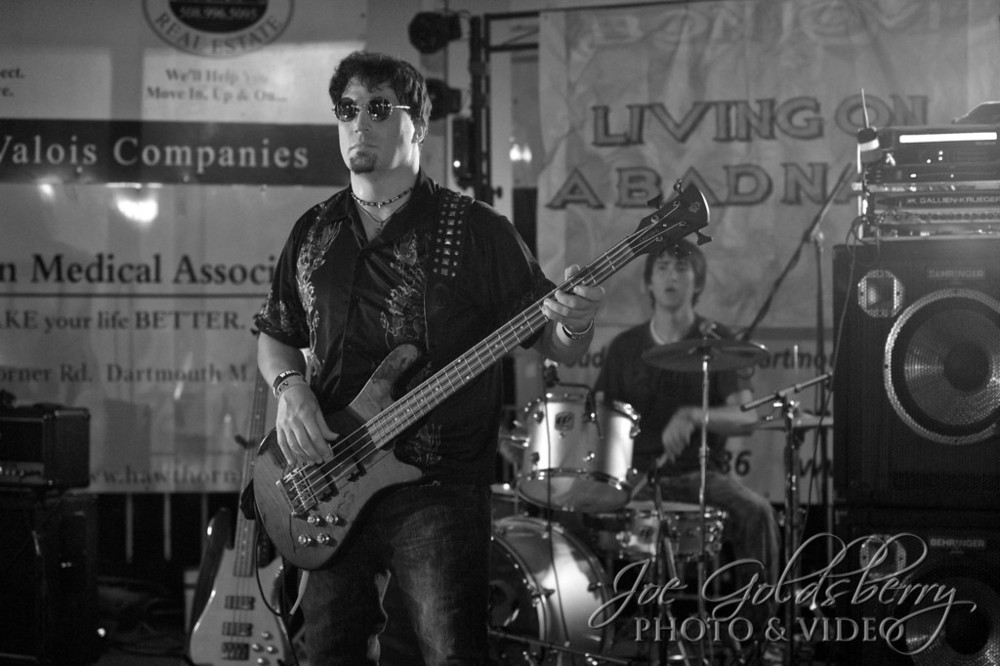Bon Jovi tribute band Living on a Bad Name bassist John Miker, with drummer Keith Pittman in the background.