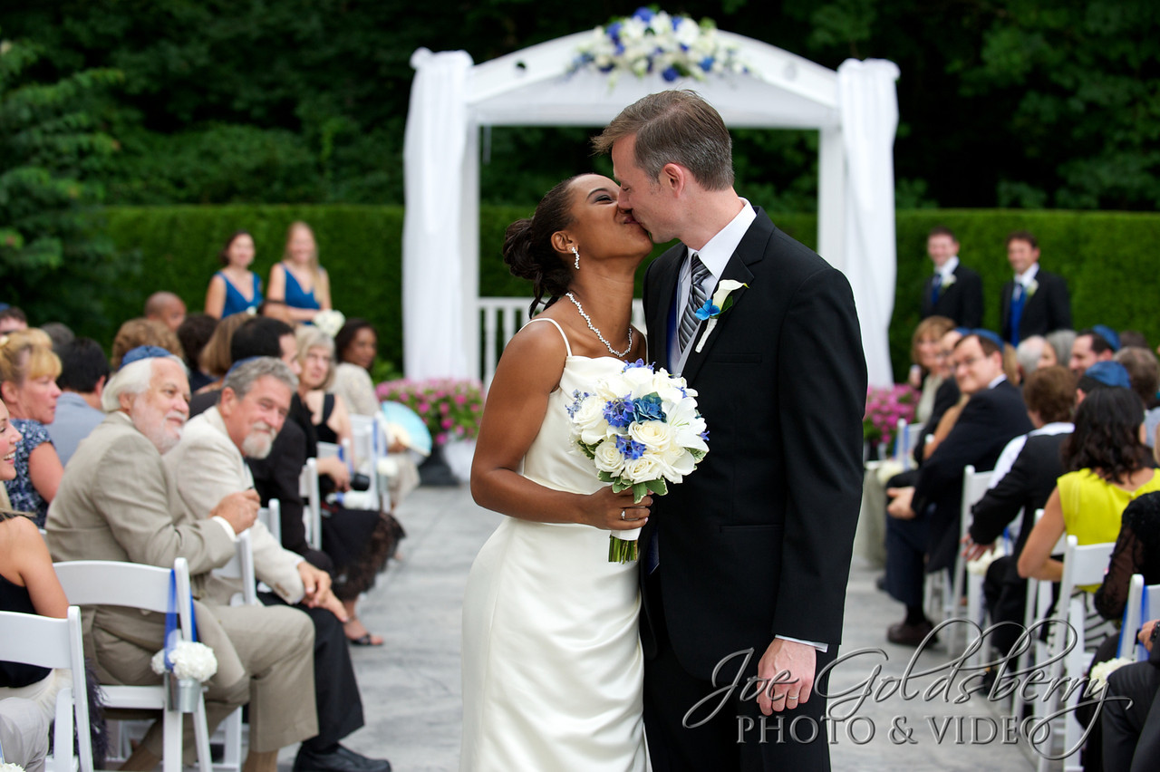 The recessional, man & wife, and a quick kiss...