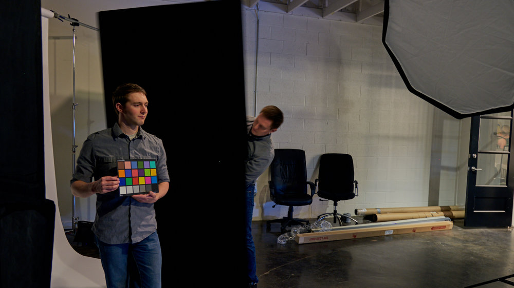 Joseph, our shoot assistant, stood in with the color checker as Mike made some lighting adjustments with the 4-foot floppy (an expandable flag).