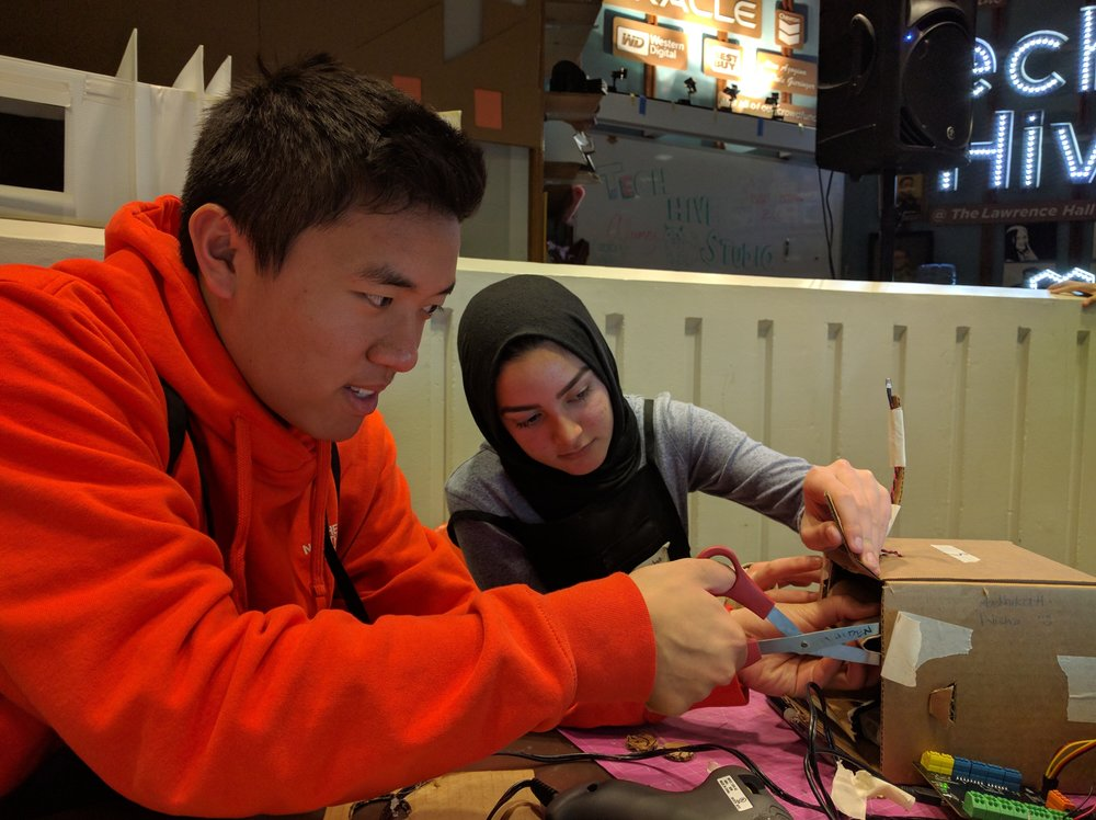 Edmond and Madeeha modify the edges of the moving eye mechanism in their angler.