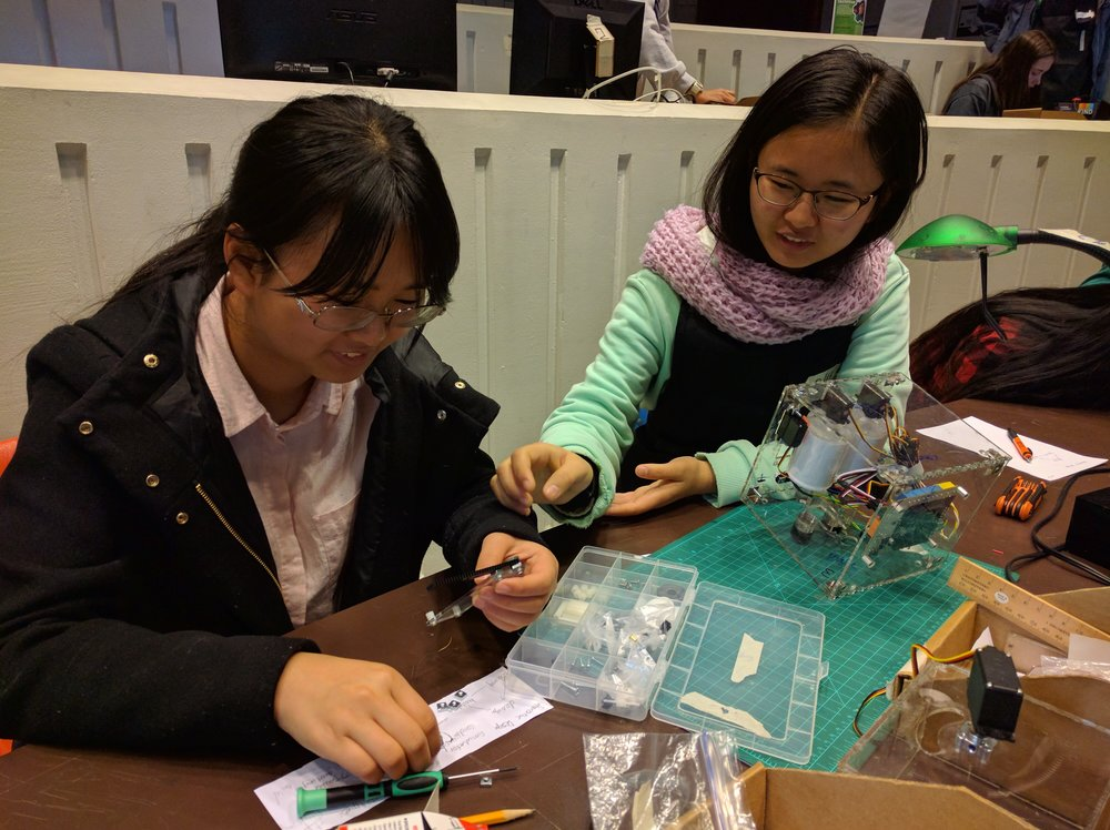 Qiyao and Qilu finishing up their robot.