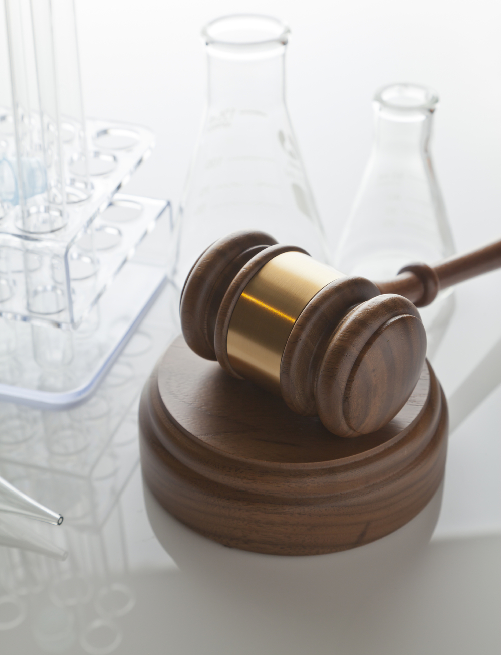 stock-photo-19597122-gavel-laboratory-equipment.jpg