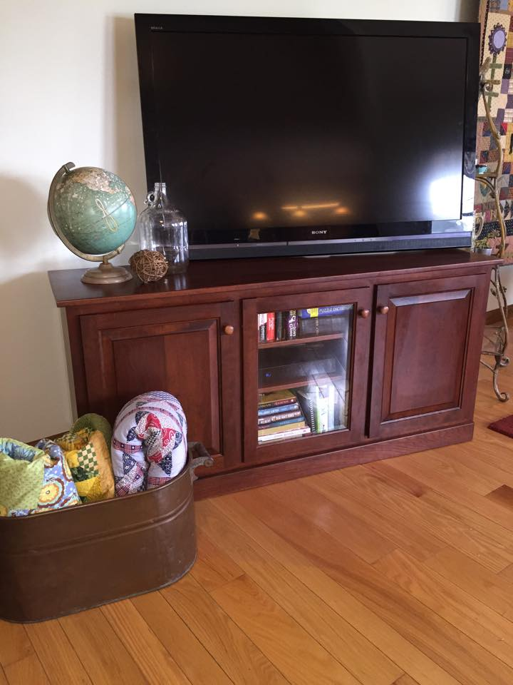 Better placement of the tv helped this room a lot. So did finding fun items to decorate with, that globe was hiding in the basement and the shelves next to the tv were on the porch, sometimes pieces need to find new homes!