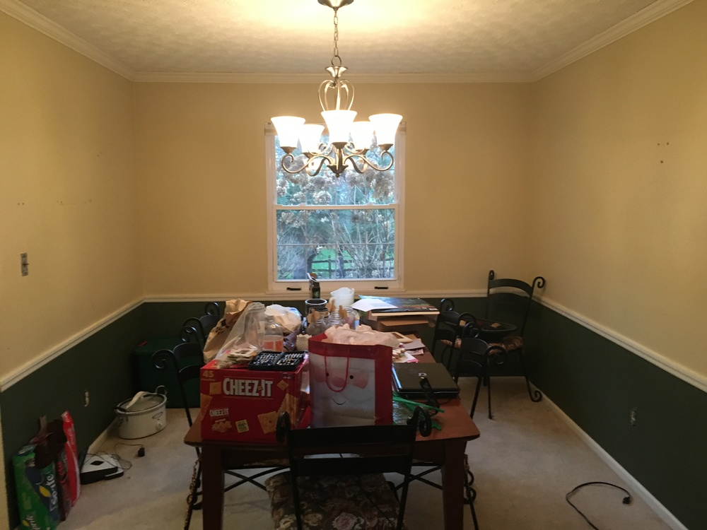 Pretty standard dining room here! We asked, and thankfully they agreed, to paint the walls. Fresh paint is the easiest way to freshen up a room!