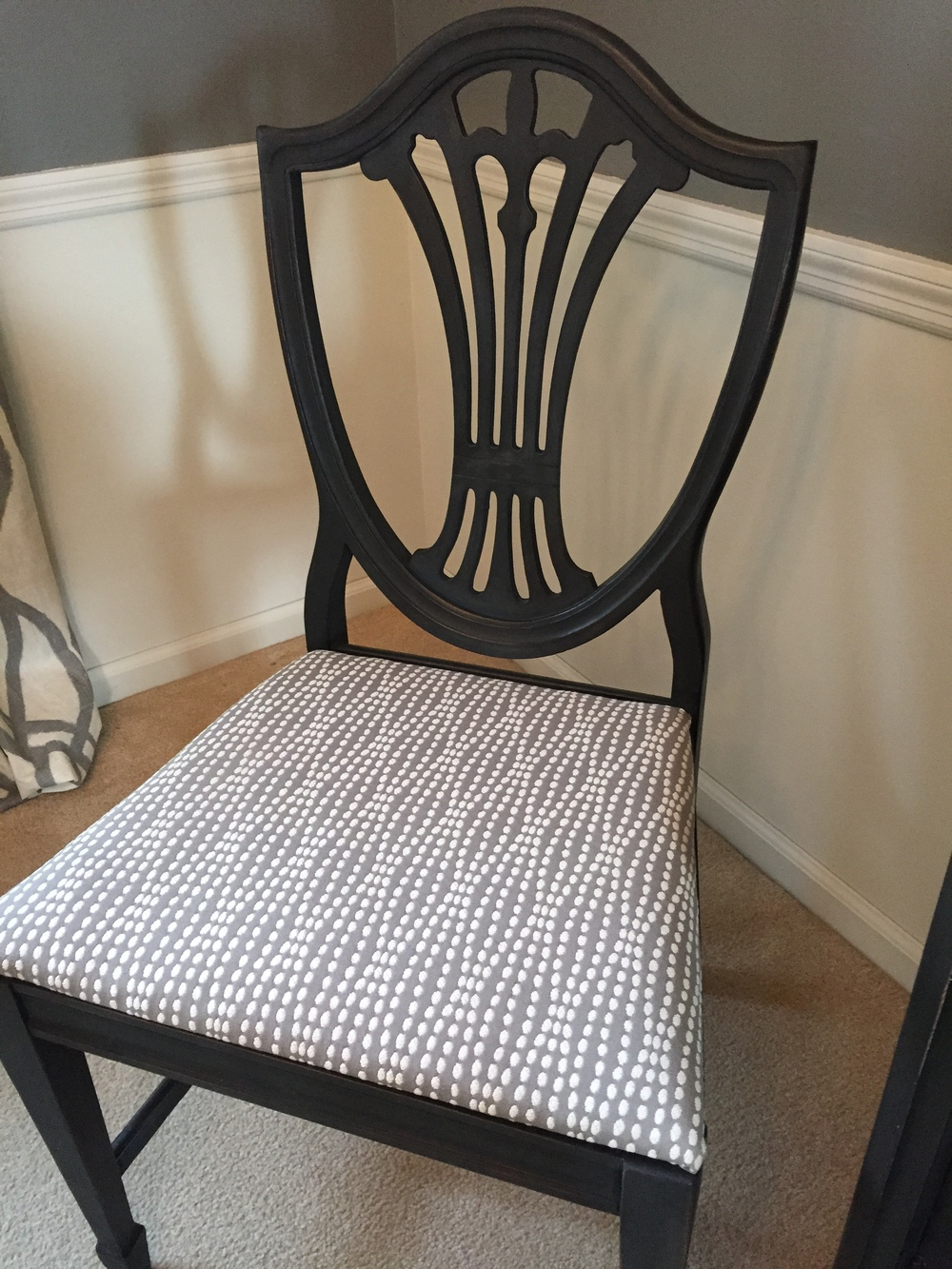 Two chairs were done in a contrasting fabric. One reason was that the back of one chair was broken, so filling it and upholstering the back solved the problem! We painted them with a dark grey chalk paint, then applied an antiquing wax.