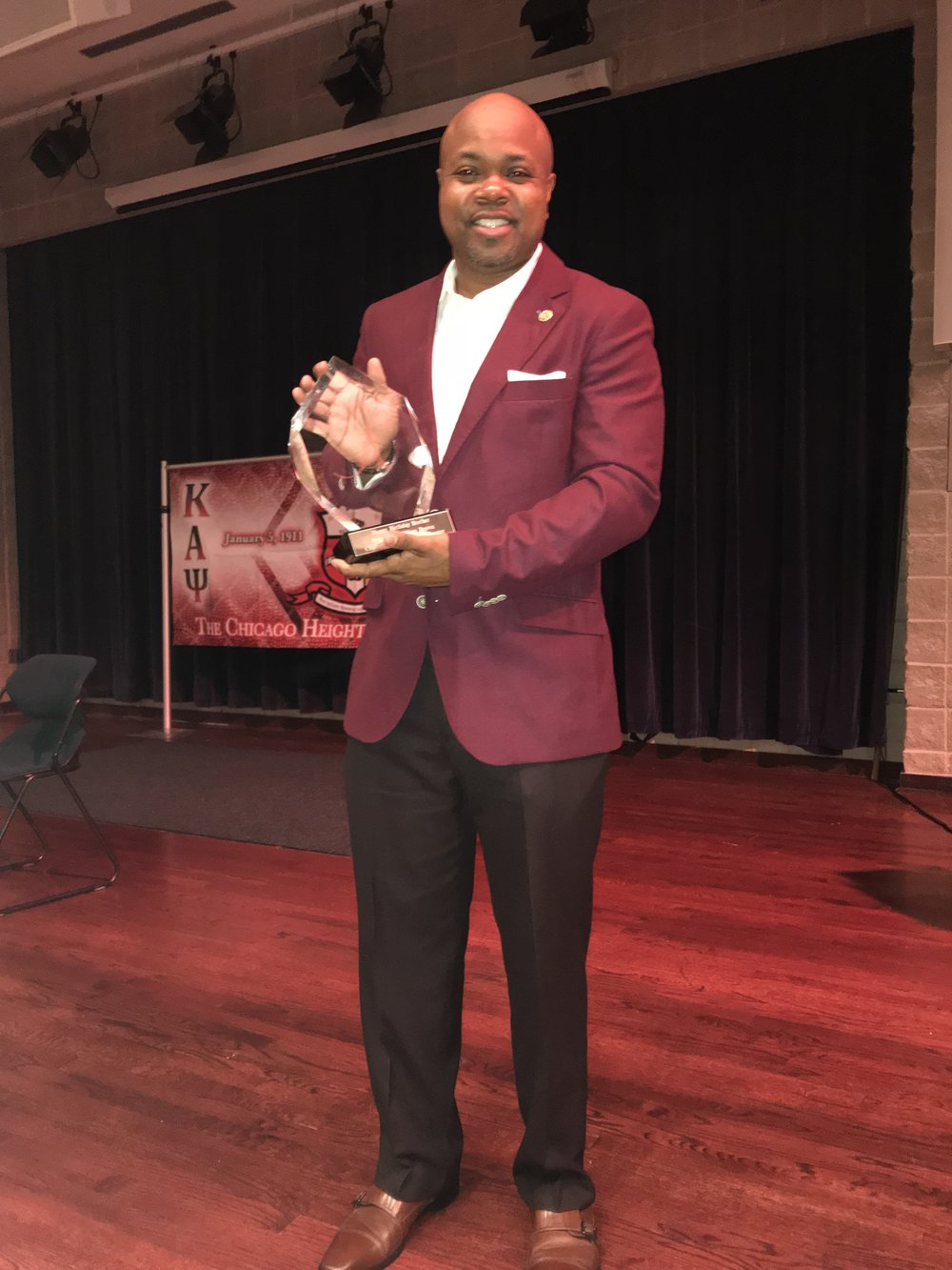Polemarch William Brown, receiving an award.