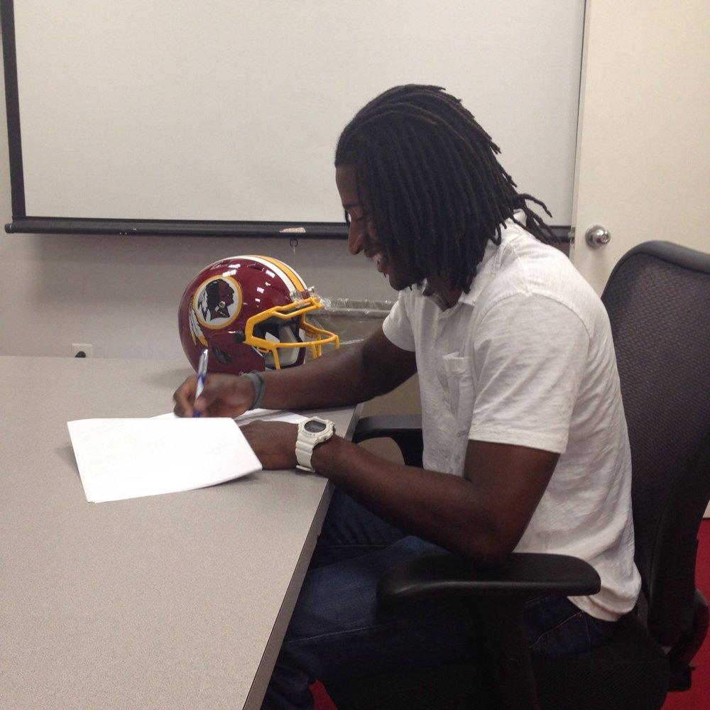 Andre Roberts_signing.jpeg